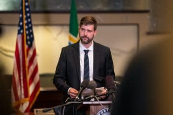 Mike Schmidt, Multnomah County district attorney, speaks to the media at City Hall in Portland, Oregon on August 30, 2020. Photo: Nathan Howard/Getty Images