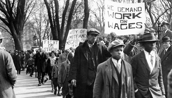 Work or Wages sign during demonstration