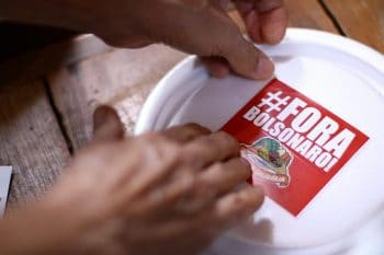 During the sixth Marmita Solidária ('Solidarity Prepared Meals') in Rio de Janeiro, 300 meals were prepared with food produced by family farms in settlements organised by the MST. In addition to solidarity, the meals carry political messages with them, such as the Fora Bolsonaro ('Out, Bolsonaro') campaign. Rio de Janeiro, Brazil, 24 August 2020. MST/RJ