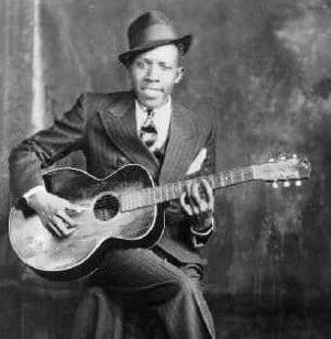 Blues guitarist Robert Johnson is evoked by Peter Linebaugh's idea of the crossroads