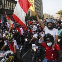A caravan of demonstrators on motorcycles ride after interim President Manuel Merino resigned his post, in Lima, Peru, Sunday, Nov. 15, 2020. (AP Photo/Rodrigo Abd)