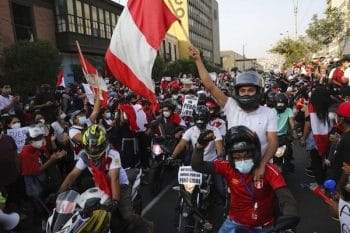 A caravan of demonstrators on motorcycles ride after interim President Manuel Merino resigned his post, in Lima, Peru, Sunday, Nov. 15, 2020. (AP Photo/Rodrigo Abd)