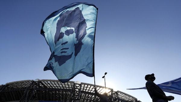 | A person waves a Diego Maradona flag outside the Stadio San Paolo © REUTERSYara Nardi | MR Online