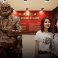 Header image: Two young women take selfies with a statue of Karl Marx and Friedrich Engels during an exhibition commemorating Marx's 200th birthday in Beijing, May 5, 2018. Chen Xiaogen/People Visual