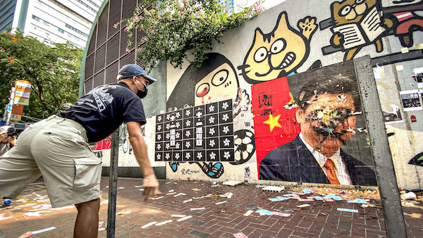 Hong Kong protester throws egg at President Xi Jinping's portrait on China's National Day, Oct. 1, 2019. (Studio Incendo, CC BY 2.0, Wikimedia Commons)