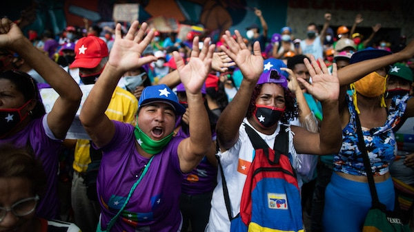 Government supporters chant for parliamentary candidates representing the Great Patriotic Pole party at a closing campaign rally in Caracas, Venezuela, Dec. 3, 2020. Ariana Cubillos   AP