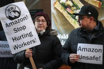 Former injured Amazon employees join labor organizers and community activists to demonstrate and hold a press conference outside of an Amazon Go store on December 10, 2019 in Chicago, Illinois. (Scott Olson / Getty Images)