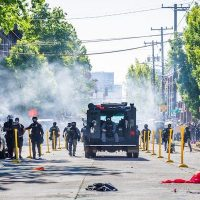 "Seattle Police Department utilizes chemical weapons to push protestors back over the ""Black Lives Matter"" mural on Capitol Hill (Derek Simeone, Flickr)"