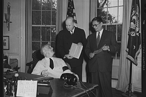 President Roosevelt and T.V. Soong, foreign minister of China, purchases from Postmaster General Walker some of the new five-cent stamps symbolizing freedom and democracy in both the United States and China. The stamp carries pictures of President Lincoln and Sun Yat-Sen, first president of China, and a Chinese inscription (Photo: Library of Congress)