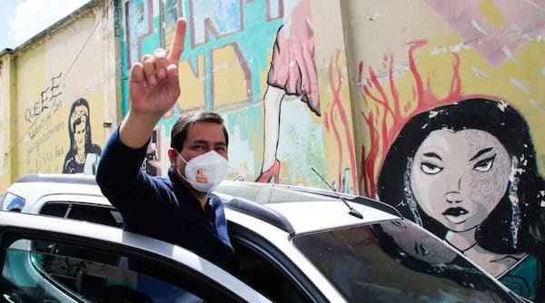 Andres Arauz, the presidential candidate for the political coalition National Union for Hope, UNES, flashes a number one finger sign as he leaves a press conference, in Quito, Ecuador, Jan. 13, 2021. Dolores Ochoa   AP