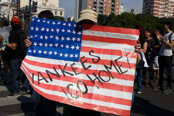 "A protester carries a sign reading ""Yankees go home!"" during a rally protesting the 2018 G20 summit in Buenos Aires, Argentina. (Montecruz Foto)"