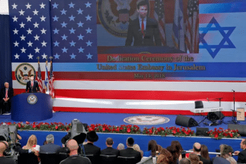 Senior White House adviser Jared Kushner delivers a speech during the opening of the U.S. Embassy in Jerusalem on May 14, 2018. Kushner's family has close personal ties to Israeli far-right leader Benjamin Netanyahu. [Source: theintercept.com]