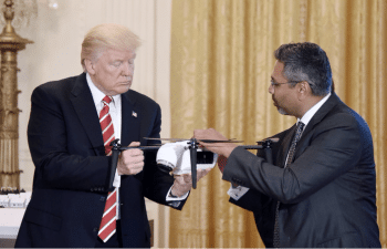 U.S President Donald Trump holds a drone as George Mathew, CEO & Chairman of Kespry, explains how it works during the American Leadership in Emerging Technology event in the East Room of the White House, June 22, 2017. [Source: newsweek.com]