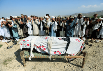 Relatives pray near a coffin during a funeral on Sept. 19, 2019 for one of the victims of a drone strike in the Khogyani district of Nangarhar province, Afghanistan. [Source: theintercept.com]