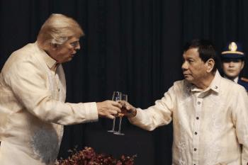 Trump toasts in Manila with Filipino leader Rodrigo Duterte whose drug war killed thousands of Filipinos. [Source: newsweek.com]