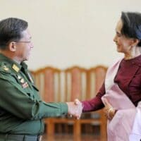 In this file photo dated Dec. 2, 2015 Myanmar military chief General Min Aung Hlaing (L) and National League for Democracy party leader Aung San Suu Kyi (R) shake hands after their meeting at the Commander in-Chief's office in Naypyidaw.