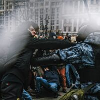Supporters of detained Russian opposition leader Alexei Navalny clash with riot police officers during an unsanctioned rally in central Moscow on 01-23-2021