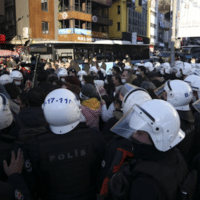 Riot police officers push back supporters of Bogazici University students during a protest in Istanbul, Thursday, Feb. 4 2021