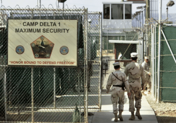 A photo reviewed by a military official before being made public shows U.S. military guards walking within the Camp Delta military-run prison in Guantanamo Bay, Cuba. AP Photo/Brennan Linsley