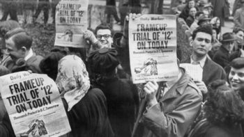Demonstrators hold up copies of the Daily Worker, predecessor of People's World, outside the Federal Courthouse in New York during the frame-up trial of Communist Party leaders. | People's World Archives
