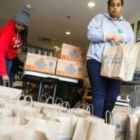 Volunteers packing food for people affected by the pandemic