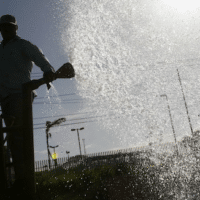 """According to the United Nations, water use has increased sixfold over the past century and is rising by about 1 per cent a year. For stock market traders in the United States, water futures offer an opportunity to lock-in water prices, but human rights campaigners say, """"it is a serious mistake to consider water a commodity"""". (AP/Esteban Felix)"""