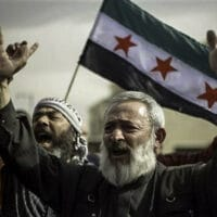 Syrians rally in front of the US Embassy to demand American military intervention and a no fly zone to stop the killings in Syria, in Amman, Jordan (Photo: Flickr - Freedom House)