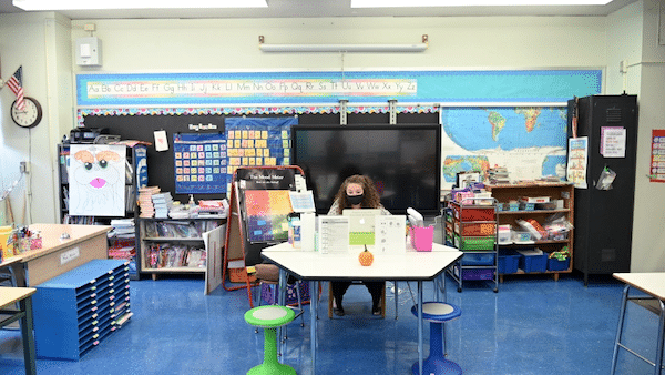 Emma Kash, a teacher at Yung Wing School P.S. 124 wears a mask and teaches remotely from her classroom on Sept. 24, 2020 in New York City. (Michael Loccisano/Getty Images)
