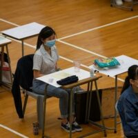 Students sit for the Diploma of Secondary Education (DSE) university entrance exams in Hong Kong on April 24, 2020