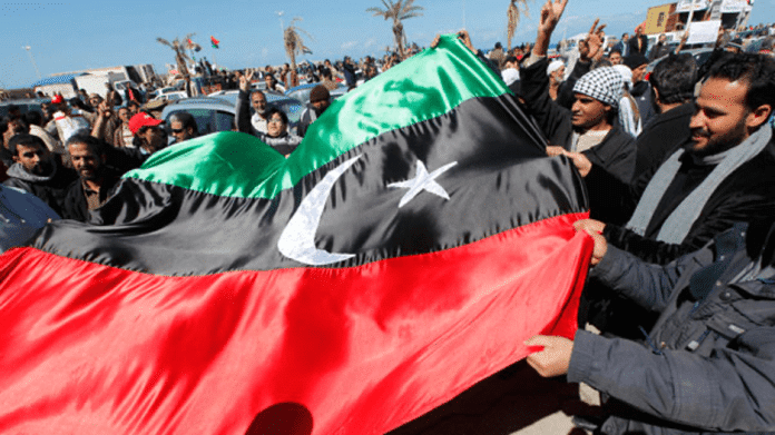   Protesters in Benghazi hoist prerevolutionary Libyan flag Source kentonxtfileswordpresscom   MR Online