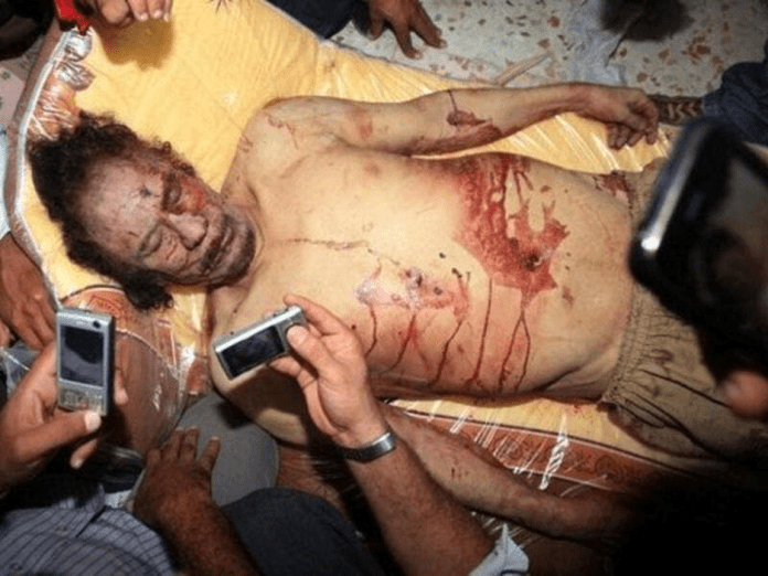   Libyans snap photos of Qaddafi after his death in Misrata Source albawabacom   MR Online