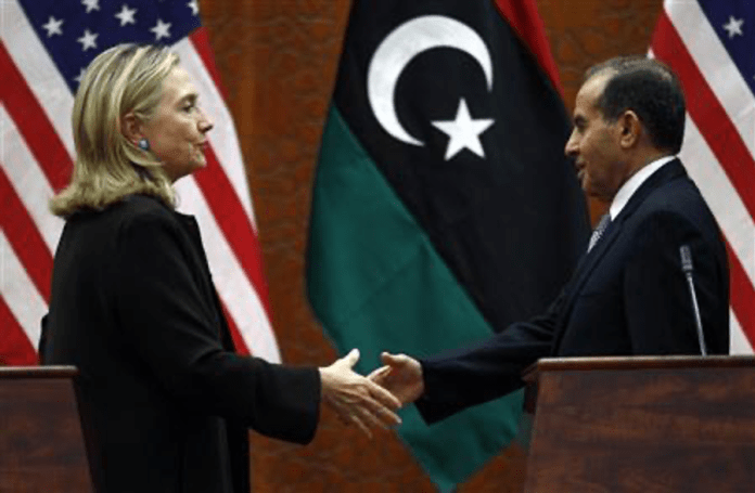   Clinton shakes hands with Jibril on October 18 2011 at the World Islamic Call Society headquarters during Clintons visit to Libya On the eve of the USNATO bombing Clinton had met with Jibril in the company of French intellectual gadfly Bernard HenriLévy and voiced support for him Source reuterscom   MR Online
