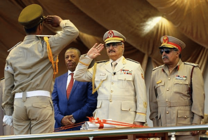  Khalifa Hiftar salutes one of his foot soldiers Source nytcom   MR Online