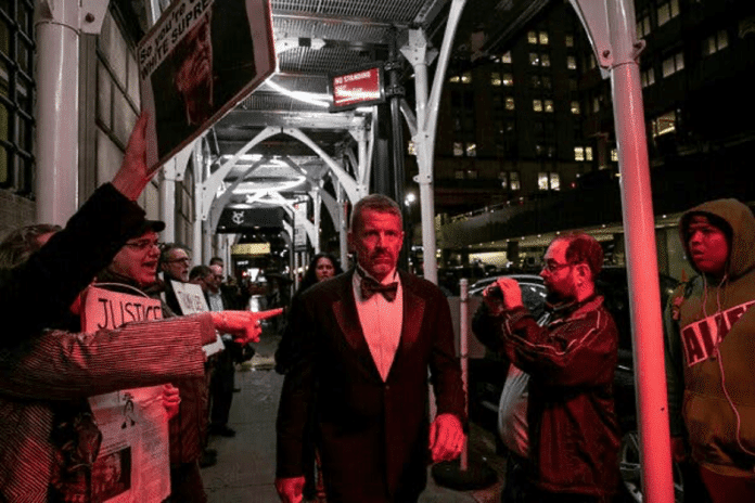  Erik Prince walks in New York City surrounded by protestors His violation of the Libyan arms embargo makes him susceptible to possible UN sanctions Source nytimescom   MR Online