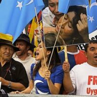 | Uwyghur People Demand Freedom with Flag of East Turkestan in front of the UN Building in NYC | MR Online
