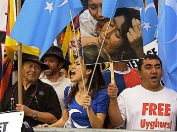 Uwyghur People Demand Freedom with Flag of East Turkestan in front of the U.N. Building in NYC