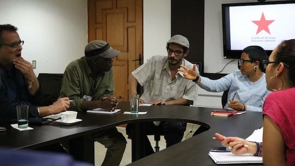 From left to right: Vijay Prashad, Fred M'membe, Diego Sequera, and Erika Farías in Caracas, 2019. Photograph taken by Yeimi Salinas.