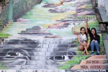 | Bertha and Laura Zúniga Cáceres at a mural made by el Colectivo Culturas Vivas Tegucigalpa Honduras 2021 | MR Online