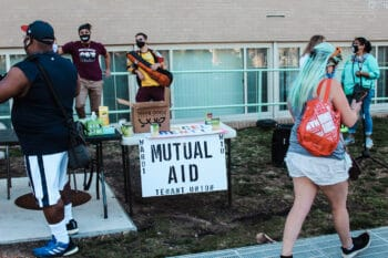 A DC Ward 1 Mutual Aid table set up at a Cancel Rent rally to support tenants. Eleanor Goldfield | ArtKillingApathy.com