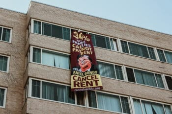A banner with a message to DC Councilmember Anita Bonds reading: '30% of our families cannot pay rent.' Eleanor Goldfield | ArtKillingApathy.com