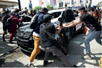 LOS ANGELES – MAY 30, 2020: Police car attacked during the protest march against police violence over death of George Floyd.