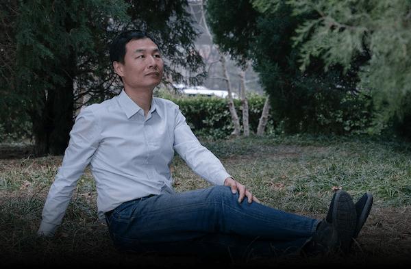 Zhang Boju poses for a photo in Beijing, March 2, 2021. Shi Yangkun/Sixth Tone)