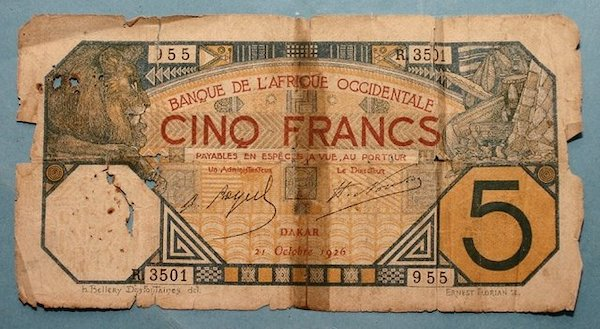 """""""Colonial 5 Franc CFA note, 1926 (recto)"""" by nebedaay is licensed with CC BY-NC-SA 2.0. To view a copy of this license, visit https://creativecommons.org/licenses/by-nc-sa/2.0/"""