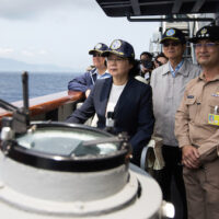 Taiwan President Tsai Ing-wen (second from left) inspects a naval destroyer during miliotary drills off the port of Su'ao ahead of planned war games by China. Photo | Military News Agency via AP