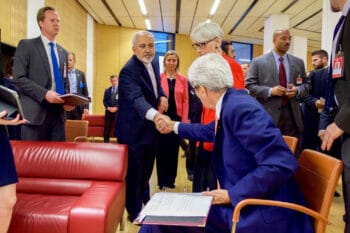 | US Secretary of State John Kerry seated saying goodbye to Iranian Foreign Minister Javad Zarif in Vienna July 14 2015 after Zarif read a declaration of the nuclear agreement in his native Farsi State Department | MR Online