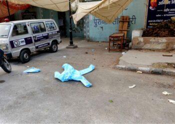 Outside the Seemapuri crematorium, a PPE kit blows out onto the street. Photo: Naomi Barton/The Wire