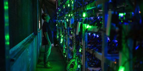   A manager checks equipment at a Bitcoin mine near Kongyu Township Sichuan province Aug 12 2016 Paul RatjeThe Washington PostPeople Visual   MR Online