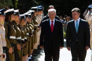 | Israels Shimon Peres left and Colombias Juan Santos smile at Israeli soldiers durizzng a ceremony in Jerusalem June 10 2013 Sebastian Scheiner | AP | MR Online