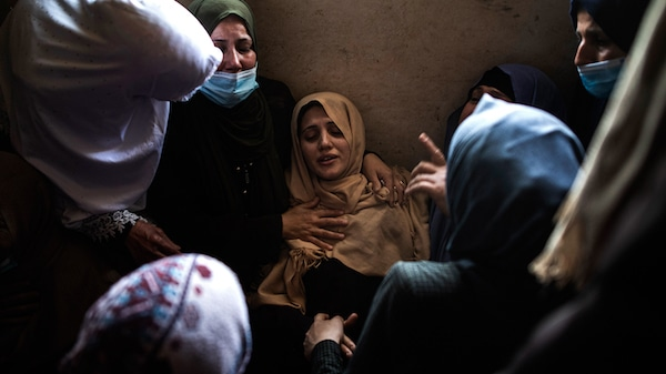Relatives of 11-year-old Hussain Hamad, who was killed by an Israeli airstrike mourn during his funeral in the family home in Beit Hanoun, northern Gaza Strip, May 11, 2021. Khalil Hamra   AP