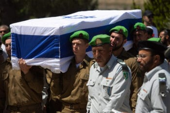 The body of Israeli soldier Omer Tabib,21, killed by an anti-tank missile near Gaza, is carried during his funeral. Sebastian Scheiner   AP
